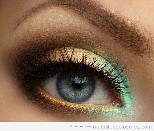 Maquillaje de ojos en tonos verdes, amarillos y naranjas