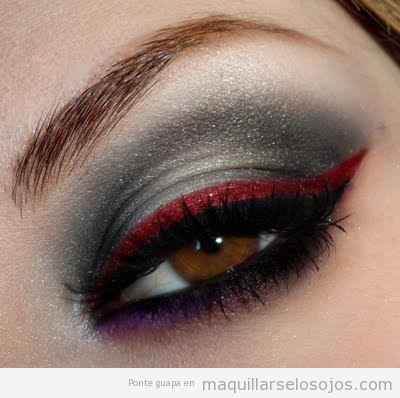 Maquillaje de ojos en rojo y gris plateado, efecto futurista
